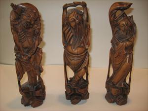 three-wood-carvings